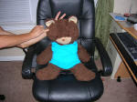 Bear in chair with rabbit's ears